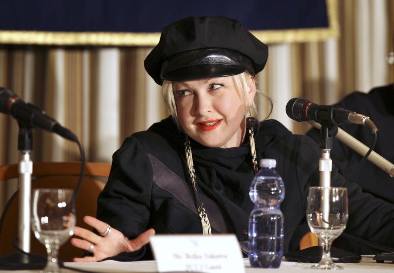 """Cyndi Lauper speaks during her press conference on her experience with the March 11 earthquake and tsunami at the Foreign Correspondents' Club of Japan in Tokyo Monday, March 12, 2012. Lauper, who is admired here as a true star who didn't run away despite the tsunami and nuclear crisis last year, is back, to show that she hasn't forgotten. """"It's a big tragedy but everybody is trying to move forward. I just want to say hey don't forget about Japan,"""" Lauper told a news conference in Tokyo. (AP Photo/Junji Kurokawa)"""