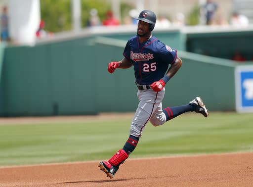 Minnesota Twins center fielder Byron Buxton (25) rounds the bases after hitting a solo-home run in the third inning of a spring training baseball game against the Boston Red Sox Wednesday, March 13, 2019, in Fort Myers, Fla. (AP Photo/John Bazemore)