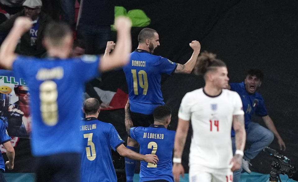 Italy's Leonardo Bonucci celebrates after he scored his side's first goal during the Euro 2020 soccer championship final between England and Italy at Wembley stadium in London, Sunday, July 11, 2021. (AP Photo/Frank Augstein, Pool)