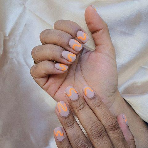 """<p>This orange squiggle shines even brighter thanks to the matte top coat. </p><p><a href=""""https://www.instagram.com/p/BvoTb2ABMJ9/"""" rel=""""nofollow noopener"""" target=""""_blank"""" data-ylk=""""slk:See the original post on Instagram"""" class=""""link rapid-noclick-resp"""">See the original post on Instagram</a></p>"""