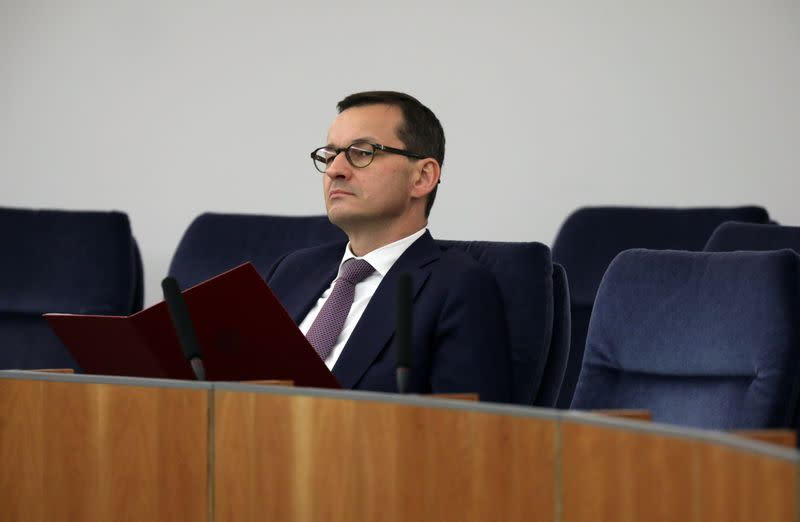 Poland's PM Morawiecki attends a debate about the Holocaust bill at the Senate in Warsaw