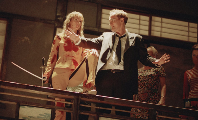Thurman and Tarantino on Kill Bill Vol. 1 set (Credit: Miramax)