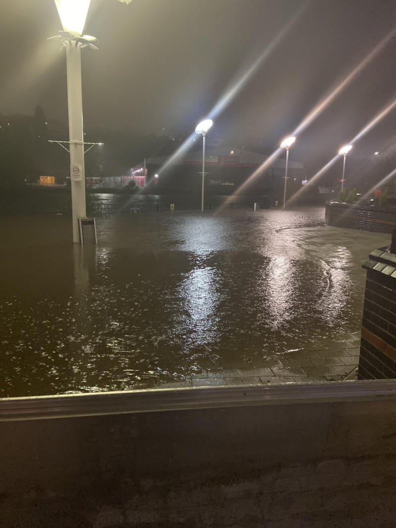 Photo taken with permission from the twitter feed of @morgannlouisee_ of flood water outside Meadowhall shopping centre, just off the M1 near Sheffield, after torrential rain hit the area. Hundreds of people have been left stranded in the shopping mall after flooding brought gridlock to surrounding roads.