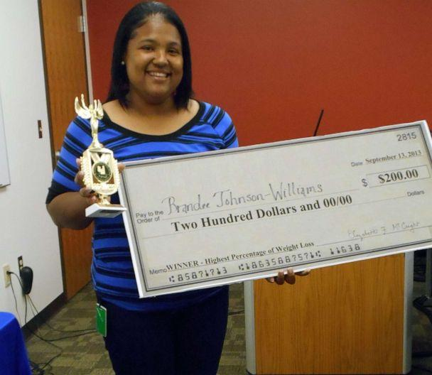 PHOTO: Brandee Johnson, 40, of Chattanooga, Tenn., holds a trophy and a check for winning an office weight loss challenge in 2013. (Courtesy Brandee Johnson)