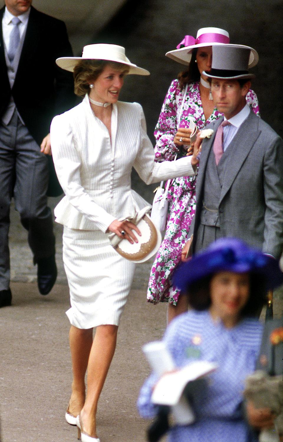 <p>Princess Diana in the royal enclosure at Royal Ascot in June 1986 wearing a cream peplum jacket and Somerville hat. <em>[Photo: Getty]</em> </p>