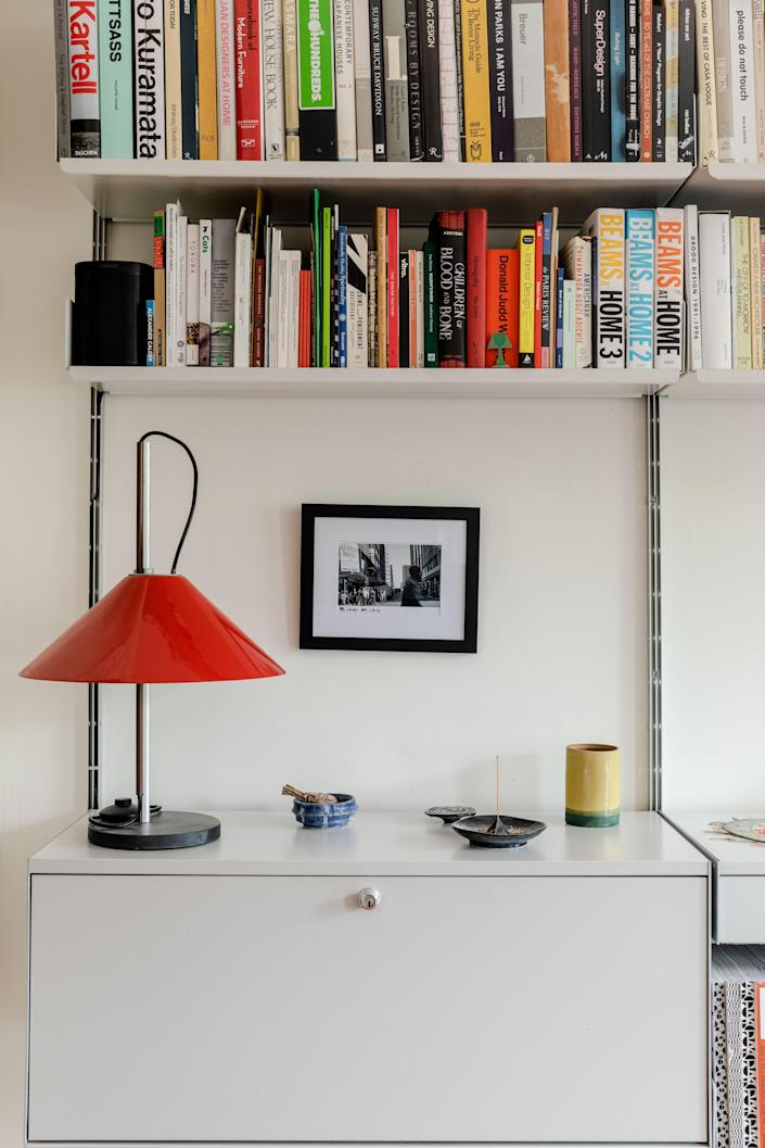 A pop of red from the Aggregato Lamp by Enzo Mari and Giancarlo Fassina brings life to the living room.
