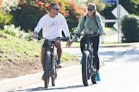 <p>Robin Wright and husband Clement Giraudet show off their multitasking prowess as they hold hands while biking on Saturday in L.A. </p>