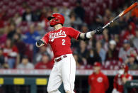 Cincinnati Reds' Nick Castellanos watches his solo home run in the bottom of the ninth inning against Washington Nationals pitcher Patrick Murphy to win a baseball game in Cincinnati, Saturday, Sept. 25, 2021. AP Photo/Paul Vernon)