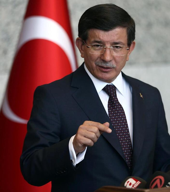 Turkey's Prime Minister Ahmet Davutoglu ordered air strikes and artillery barrages against villages in Syria after Islamic State violence spilled over into Turkey (AFP Photo/Adem Altan)