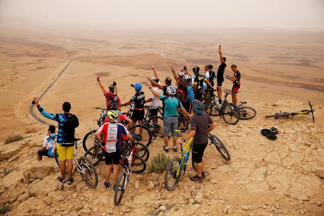Cycling - the 101st Giro d'Italia cycling race - The 229-km Stage 3 from Beersheba to Eilat, Israel - May 6, 2018 - A group of cyclists wait ahead of the arrival of Giro d'Italia riders, near Mitzpe Ramon. REUTERS/Amir Cohen