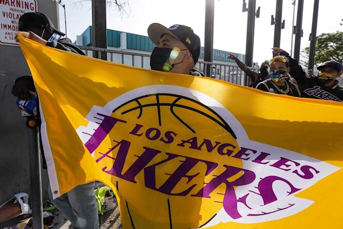 Lakers fan Chris Cielo waves before the start of the Lakers game at the Staples Center on April 15, 2021.