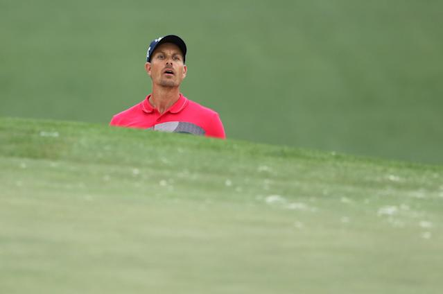Henrik Stenson of Sweden watches his sand trap shot go in the hole on the 7th for a birdie during third round play of the 2018 Masters golf tournament at the Augusta National Golf Club in Augusta, Georgia, U.S. April 7, 2018. REUTERS/Lucy Nicholson