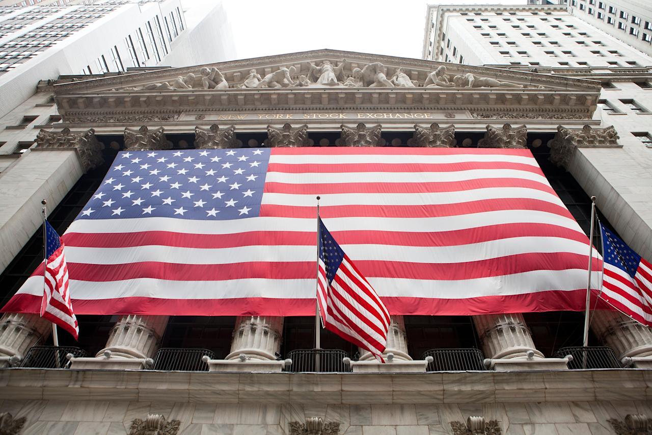 NEW YORK, NY - JULY 29:  A general view of the exterior of the New York Stock Exchange facade with the American Flag on display on July 29, 2011 in New York City.  (Photo by Dario Cantatore/Getty Images)