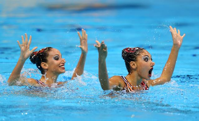 LONDON, ENGLAND - AUGUST 06: Evangelia Platanioti and Desponia Solomou of Greece compete in the Women's Duets Synchronised Swimming Free Routine Preliminary on Day 10 of the London 2012 Olympic Games at the Aquatics Centre on August 6, 2012 in London, England. (Photo by Clive Rose/Getty Images)
