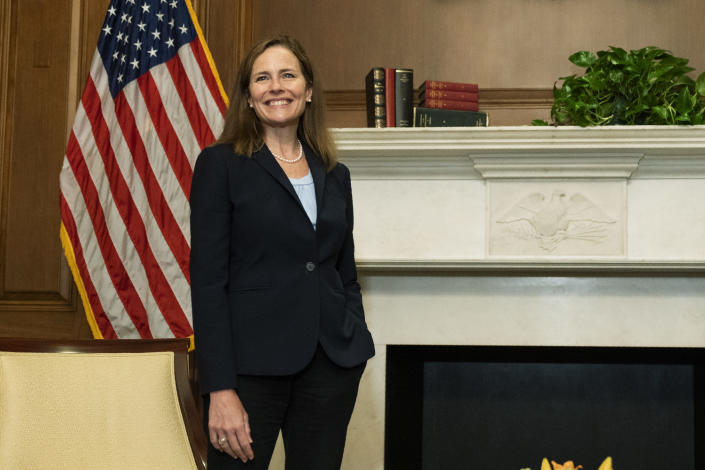 Supreme Court nominee Judge Amy Coney Barrett, smiles during a meeting with Sen. David Purdue, R-Ga., on Capitol Hill, Wednesday, Sept. 30, 2020, in Washington. (AP Photo/Manuel Balce Ceneta, POOL)