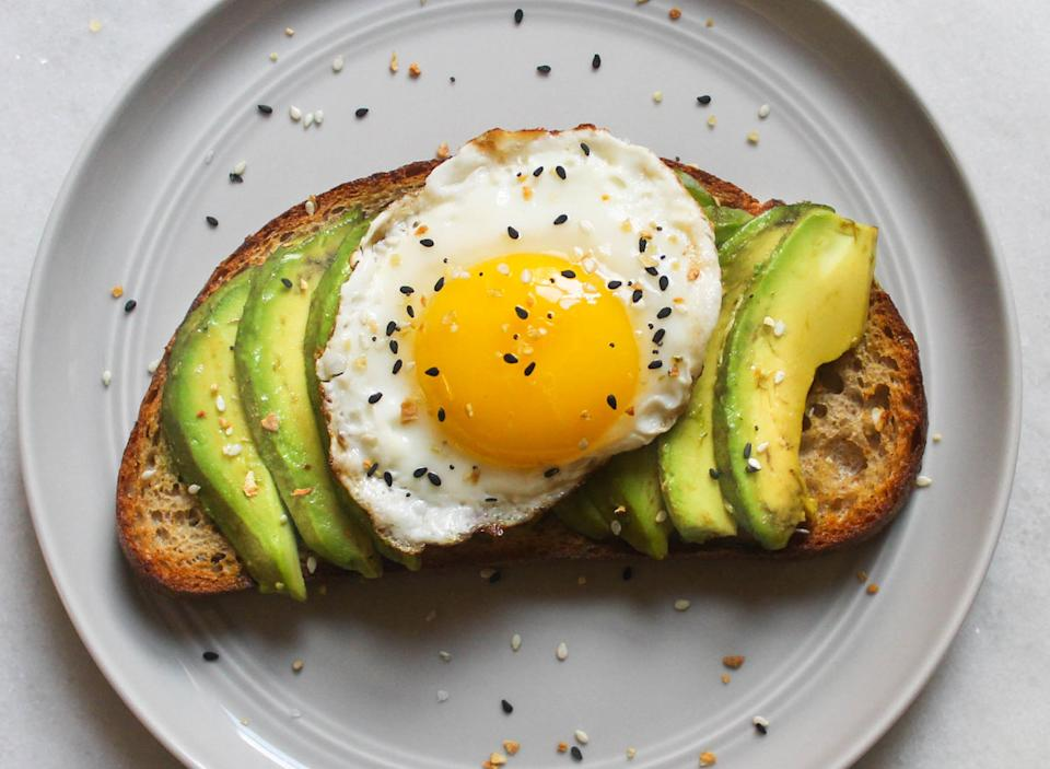 avocado egg everything bagel seasoning toast on grey plate and marble counter