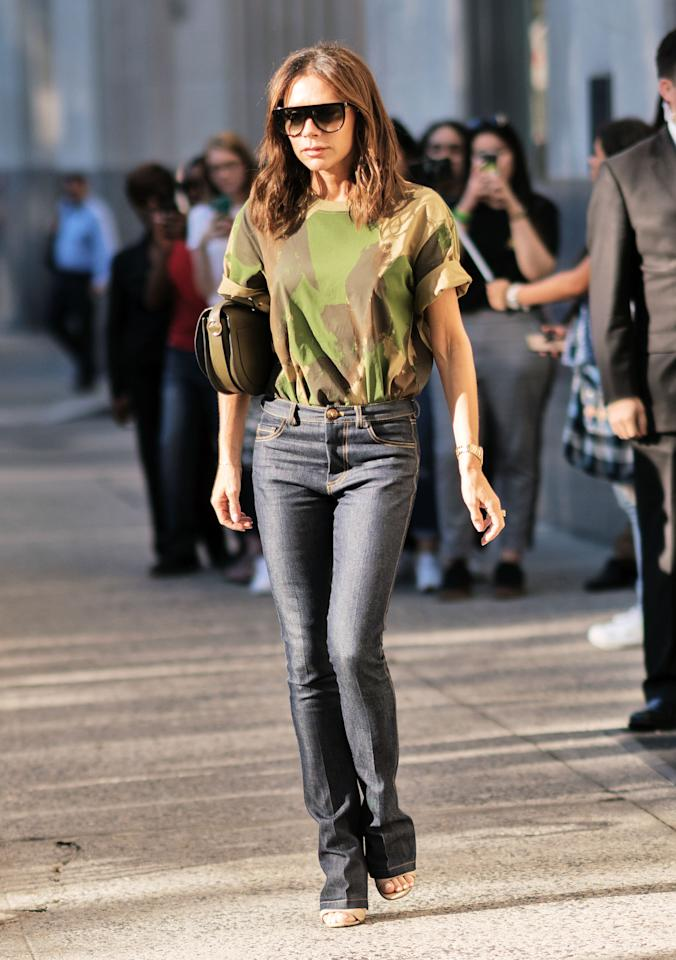 <p>There was a rare sighting of VB wearing jeans which she paired with a camo top in Manhattan. The designer usually sticks to dresses, but we love to see this more casual look on her. <br /><em>[Photo: Getty]</em> </p>