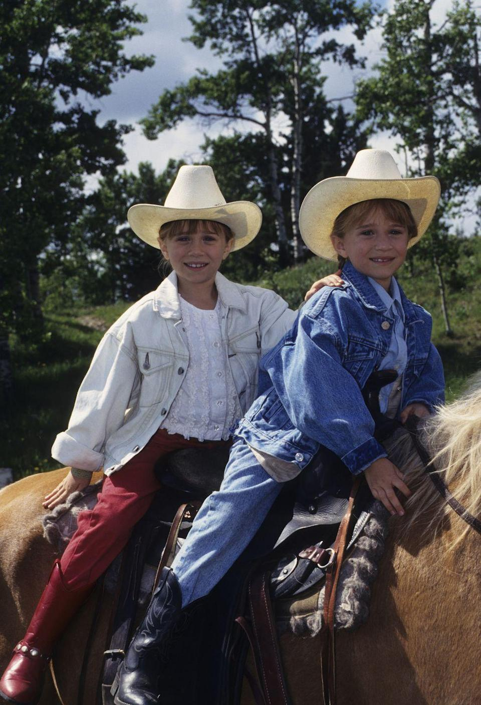<p>There is nothing more '90s than a young Mary-Kate and Ashley Olsen in matching outfits. The twins make a case for denim in oversized jean jackets in their film, <em>How the West Was Fun</em>.  </p>