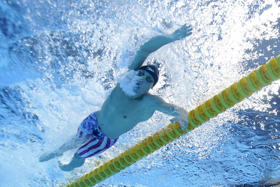 Robert Finke, of the United States, swims win the gold medal in the men's 1500-meter freestyle final at the 2020 Summer Olympics, Sunday, Aug. 1, 2021, in Tokyo, Japan. (AP Photo/Jeff Roberson)