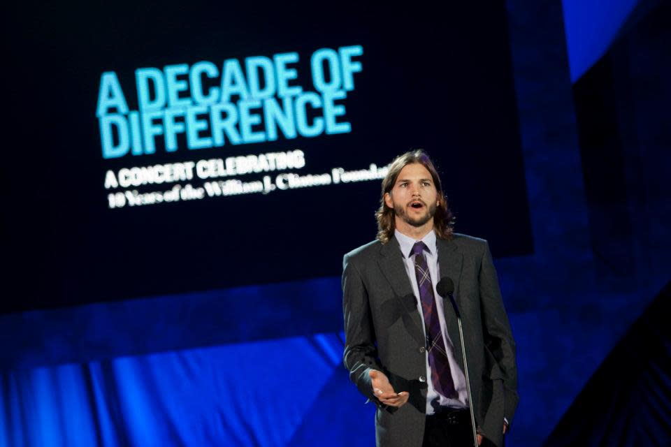 "<span>Ashton Kutcher</span> introduced Usher during ""A Decade of Difference"" concert.<br><br>(Photo by Adam Schultz / Clinton Foundation)"