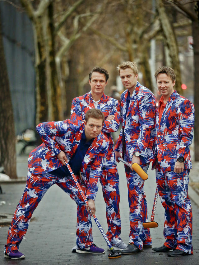 <p>Members of the Norwegian men's Olympic curling team, Christoffer Svae, far left, Thomas Ulsrud, second from left, Haavard Peterson, second from right, and Torger Nergaard, far right, show off their unique uniforms, Tuesday Jan. 23, 2018, in New York. The team is expected to be a fan favorite for a third straight Olympics thanks to the brightly colored pants that stand out. (AP Photo/Bebeto Matthews) </p>