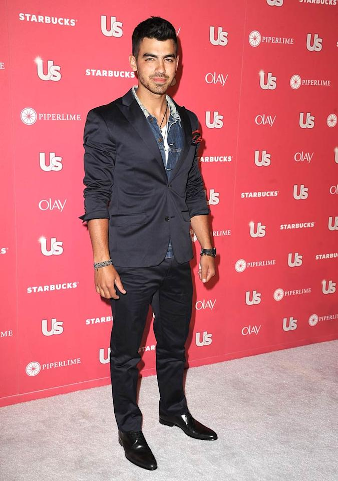 "Heartthrob Joe Jonas was one of the night's four male honorees and received ""The Laid-back Rocker' award. Too bad he opted to wear this mismatched ensemble for the occasion! Steve Granitz/<a href=""http://www.wireimage.com"" target=""new"">WireImage.com</a> - April 26, 2011"