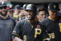 CORRECTS CITY TO CINCINNATI NOT COLUMBUS - Pittsburgh Pirates' Starling Marte (6) celebrates in the dugout after hitting a two-run home run off Cincinnati Reds relief pitcher David Hernandez in the eighth inning during the first baseball game of a doubleheader, Monday, May 27, 2019, in Cincinnati. (AP Photo/John Minchillo)
