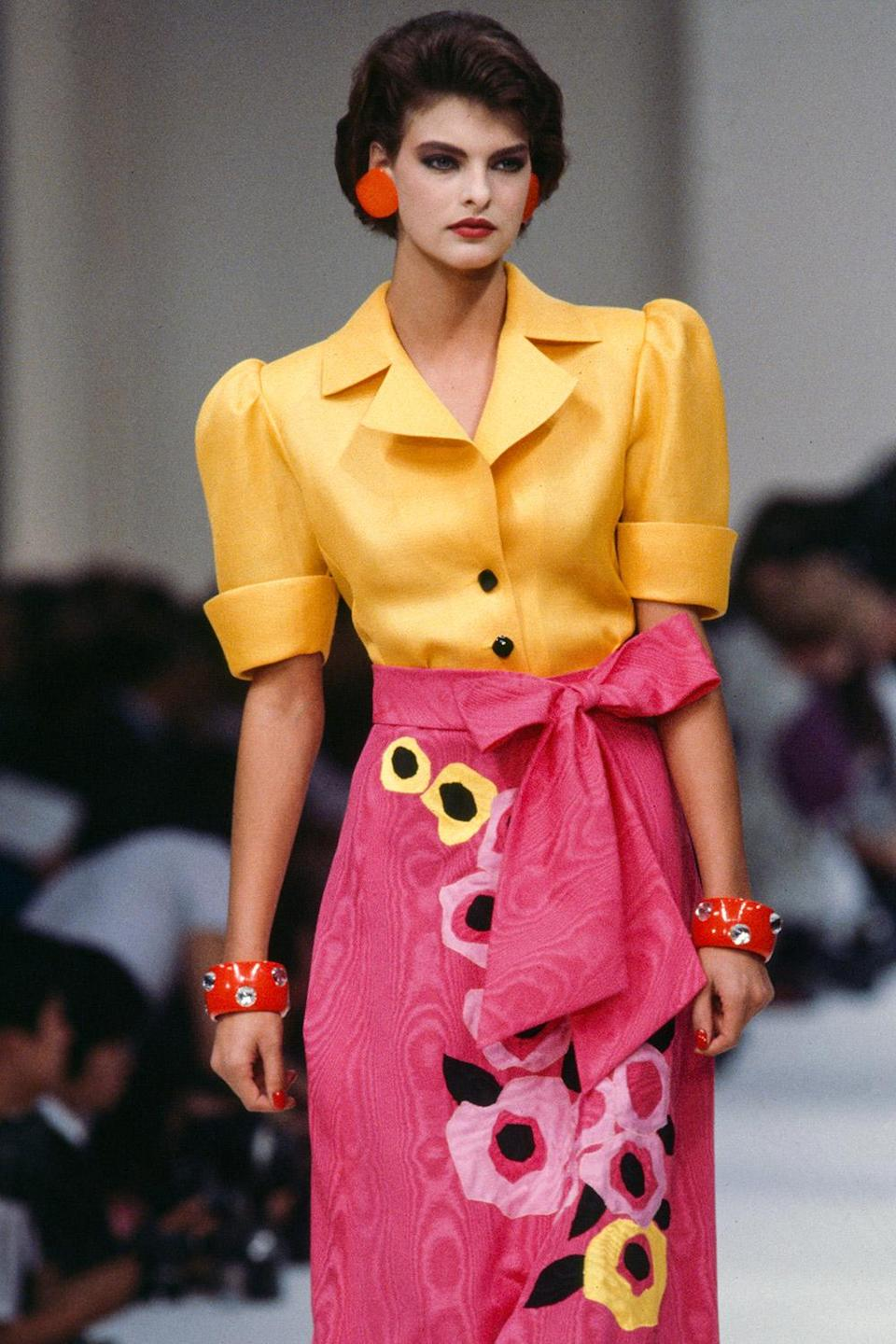 <p>In bold hues and prints at the Yves Saint Laurent show in Paris in 1985.</p>
