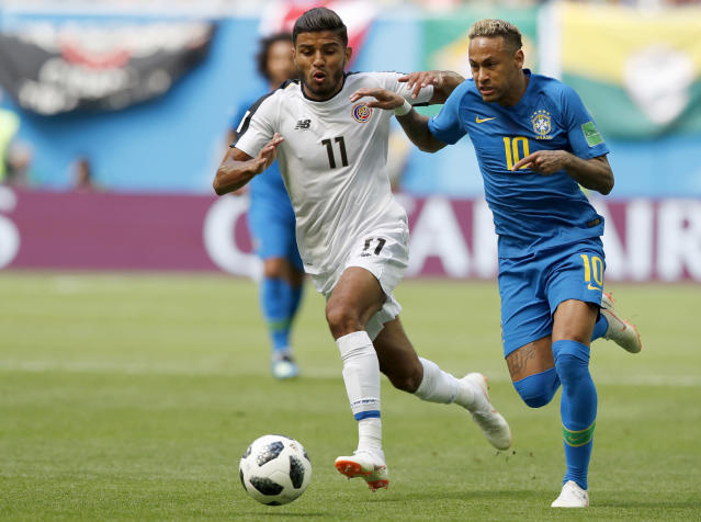 Brazil's Neymar takes the ball past Costa Rica's Johan Venegas, left, during the group E match between Brazil and Costa Rica at the 2018 soccer World Cup in the St. Petersburg Stadium in St. Petersburg, Russia, Friday, June 22, 2018. (AP Photo/Alastair Grant)