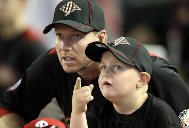 PHOENIX, AZ - JULY 11: National League All-Star Roy Halladay #34 of the Philadelphia Phillies looks on with his son Ryan during the 2011 State Farm Home Run Derby at Chase Field on July 11, 2011 in Phoenix, Arizona. (Photo by Christian Petersen/Getty Images)