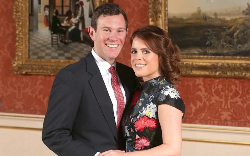 Princess Eugenie and Jack Brooksbank, pictured on the day of their engagement, will marry in St George's Chapel at Windsor Castle - PA