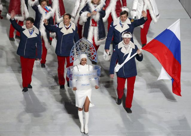 Russia's flag-bearer Alexander Zubkov leads his country's contingent during the athletes' parade at the opening ceremony of the 2014 Sochi Winter Olympics, February 7, 2014. REUTERS/Lucy Nicholson (RUSSIA - Tags: OLYMPICS SPORT)