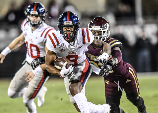 Mississippi wide receiver Elijah Moore (8) is chased by Mississippi State safety Brian Cole II (32) during an NCAA college football game in Starkville, Miss., Thursday, Nov. 28, 2019. (Bruce Newman/The Oxford Eagle via AP)
