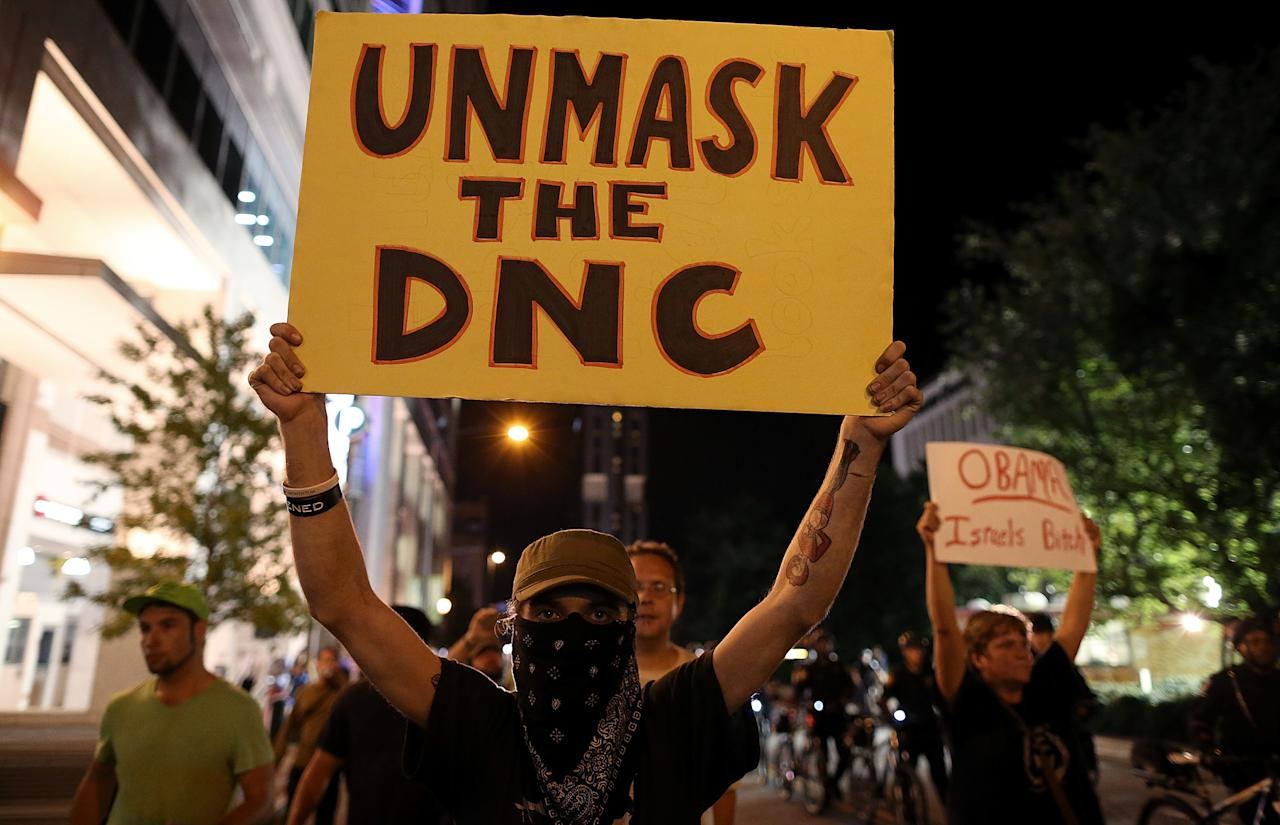 Protesters march before facing off with law enforcement officers on September 5, 2012 in Charlotte, North Carolina. Protesters marched through the streets of Charlotte, North Carolina on the second day of the Democratic National Convention as former President Bill Clinton adressed the convention.  (Photo by Tom Pennington/Getty Images)