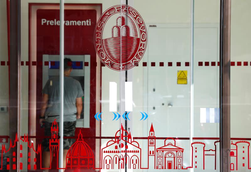 The logo of Monte dei Paschi di Siena bank is seen in a bank entrance in Rome