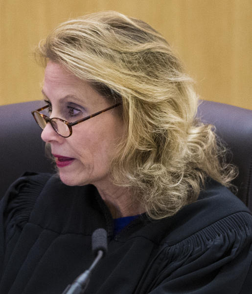 Judge Sherry Stephens reads written questions from the jury to Jodi Arias during her murder trial, Thursday, March 7, 2013 in Maricopa County Superior Court in Phoenix. Arias is on trial for the 2008 murder of Travis Alexander. (AP Photo/The Arizona Republic, Tom Tingle, Pool)