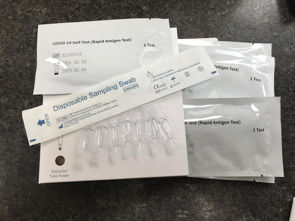 A package of seven NHS Test and Trace COVID-19 self-testing kits (Rapid Antigen Test) which has been received through the mail after ordering online for use at home. To help stop the spread of the virus the Government has introduced asymptomatic testing for certain people without symptoms who are being asked to check whether they are infected with the virus. Picture date: Monday March 8, 2021. (Photo by Zoe Linkson/PA Images via Getty Images)