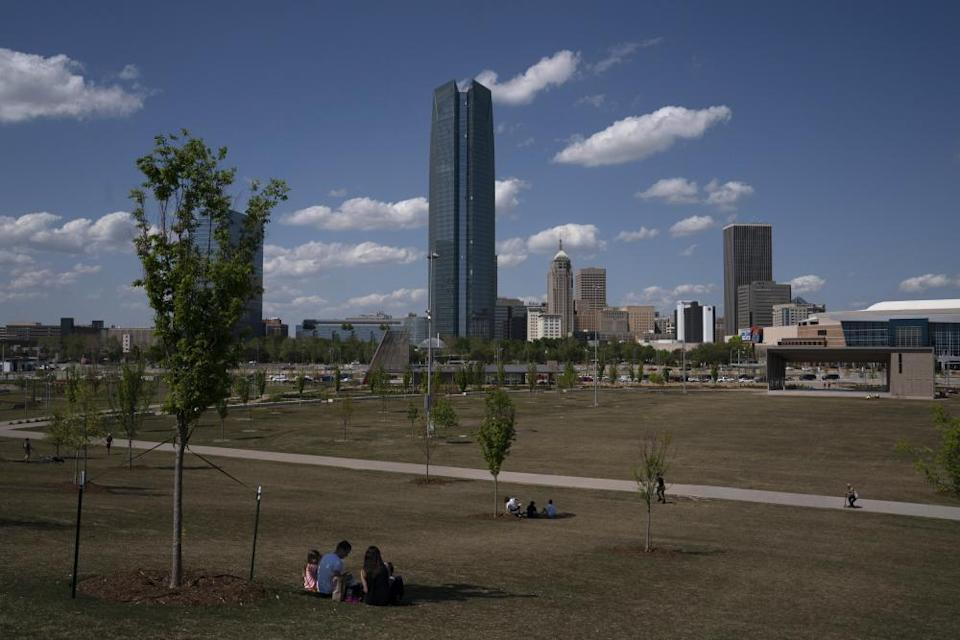 "<span class=""element-image__caption"">People sit at a distance in downtown Oklahoma City in late April.</span> <span class=""element-image__credit"">Photograph: Nick Oxford/Bloomberg via Getty Images</span>"