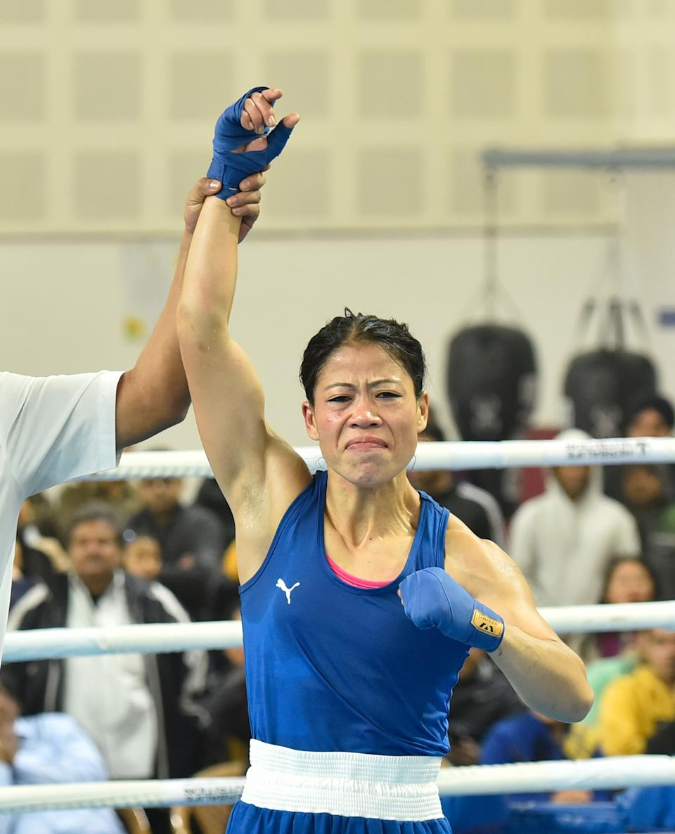 NEW DELHI, INDIA  DECEMBER 28: Mary Kom reacts to her win against Nikhat Zareen during their 51kg category finals bout of the women's boxing trials for Olympics 2020 qualifiers at Indira Gandhi Indore Stadium, on December 28, 2019 in New Delhi, India. Mary Kom (51kg), six-time world champion, defeated Nikhat Zareen in a split verdict trial bout to make the Indian team for next year's Olympic qualifiers in China. (Photo by Sanjeev Verma/Hindustan Times via Getty Images)