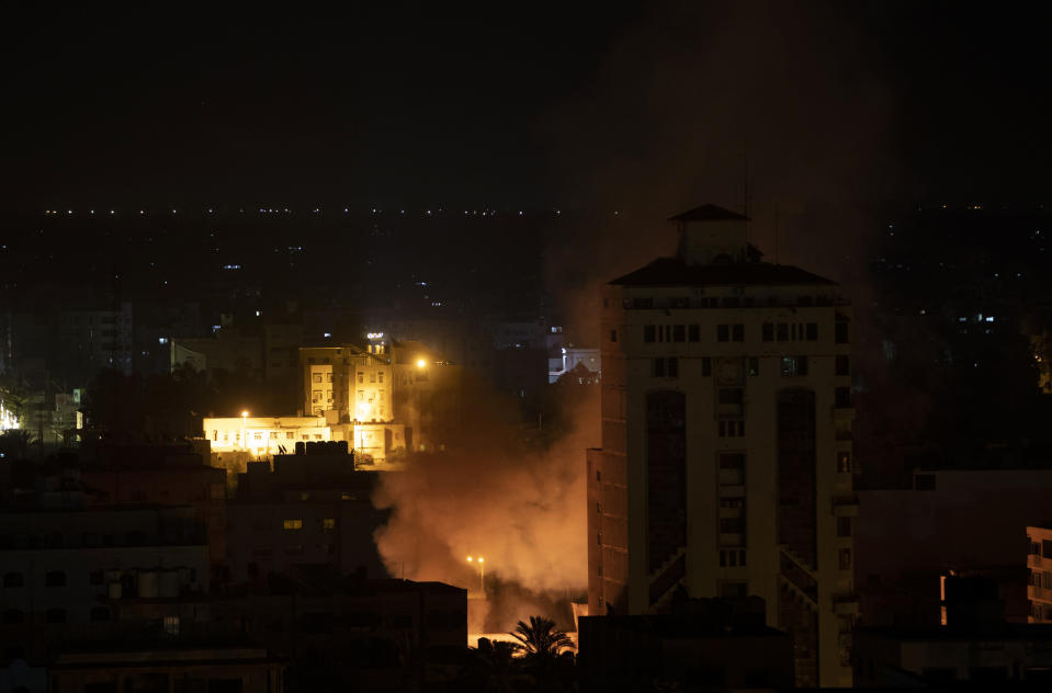 Smoke rises following Israeli missile strikes on Gaza City, Friday, May 14, 2021. Early Friday, the Israeli military said air and ground troops struck Gaza in what appeared to be the heaviest attacks yet. Masses of red flames illuminated the skies as the deafening blasts from the outskirts of Gaza City jolted people awake. (AP Photo/Khalil Hamra)