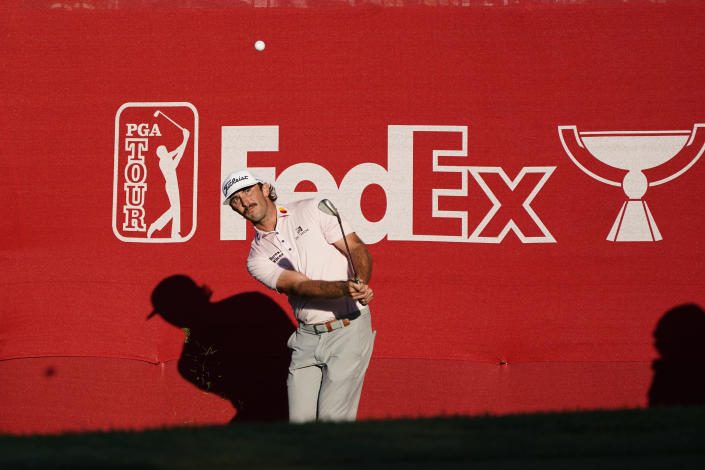 Max Homa hits the ball up to the 18th green of the Silverado Resort North Course during the final round of the Fortinet Championship PGA golf tournament Sunday, Sept. 19, 2021, in Napa, Calif. Homa won the tournament. (AP Photo/Eric Risberg)