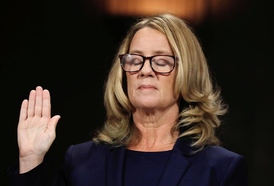 """Christine Blasey Ford closes her eyes as she is sworn in before testifying to the Senate Judiciary Committee confirmation hearing for President Donald Trump's Supreme Court nominee Judge Brett Kavanaugh on Capitol Hill in Washington, U.S., September 27, 2018. Reuters photographer Jim Bourg: """"The moment looks peaceful as if Christine Blasey Ford had closed her eyes in thought, but the image actually reflects the fact that in the nine seconds that she had her hand up to be sworn in to testify, she blinked several times. Blasey Ford began her testimony by saying: 'I am here today not because I want to be. I am terrified. I am here because I believe it is my civic duty to tell you what happened to me while Brett Kavanaugh and I were in high school.'"""" REUTERS/Jim Bourg  SEARCH """"TRUMP POY"""" FOR FOR THIS STORY. SEARCH """"REUTERS POY"""" FOR ALL BEST OF 2018 PACKAGES. TPX IMAGES OF THE DAY."""