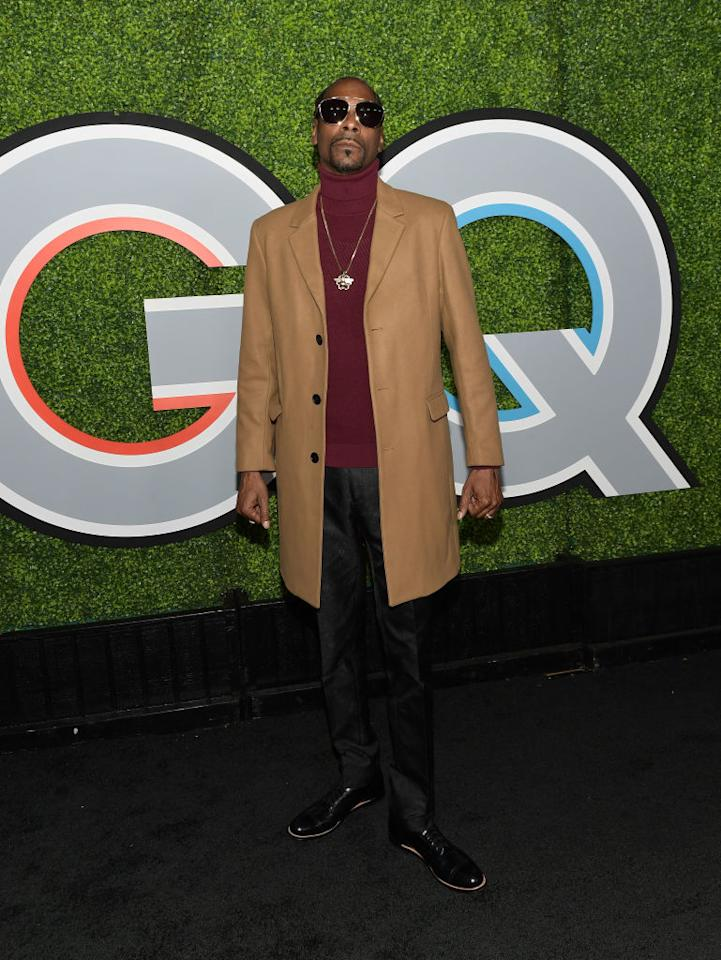 <p>The rapper worked the black carpet like a pro, rocking a camel jacket and plum turtleneck with a pair of sunglasses. (Photo: Getty Images) </p>