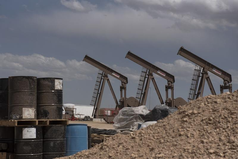 A row of pumpjacks is seen as U.S. Vice President Mike Pence, not pictured, tours a Diamondback Energy Inc. oil rig in Midland, Texas, U.S., on Wednesday, April 17, 2019. Pence gave remarks to employees regarding the impacts of the Administration's United States-Mexico-Canada Agreement. Photographer: Callaghan O'Hare/Bloomberg via Getty Images