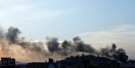 Smoke rises from a residential area near Yemen's state-run TV building during an attack from Shi'ite Houthi rebels in Sanaa