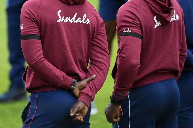 Players wearing black armbands in memory of former West Indian Batsman Sir Everton Weekes