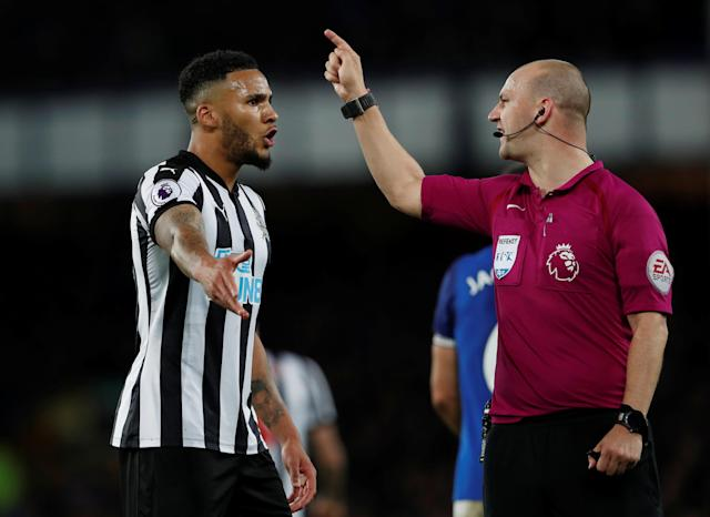 "Soccer Football - Premier League - Everton v Newcastle United - Goodison Park, Liverpool, Britain - April 23, 2018 Newcastle United's Jamaal Lascelles speaks with referee Robert Madley Action Images via Reuters/Lee Smith EDITORIAL USE ONLY. No use with unauthorized audio, video, data, fixture lists, club/league logos or ""live"" services. Online in-match use limited to 75 images, no video emulation. No use in betting, games or single club/league/player publications. Please contact your account representative for further details."