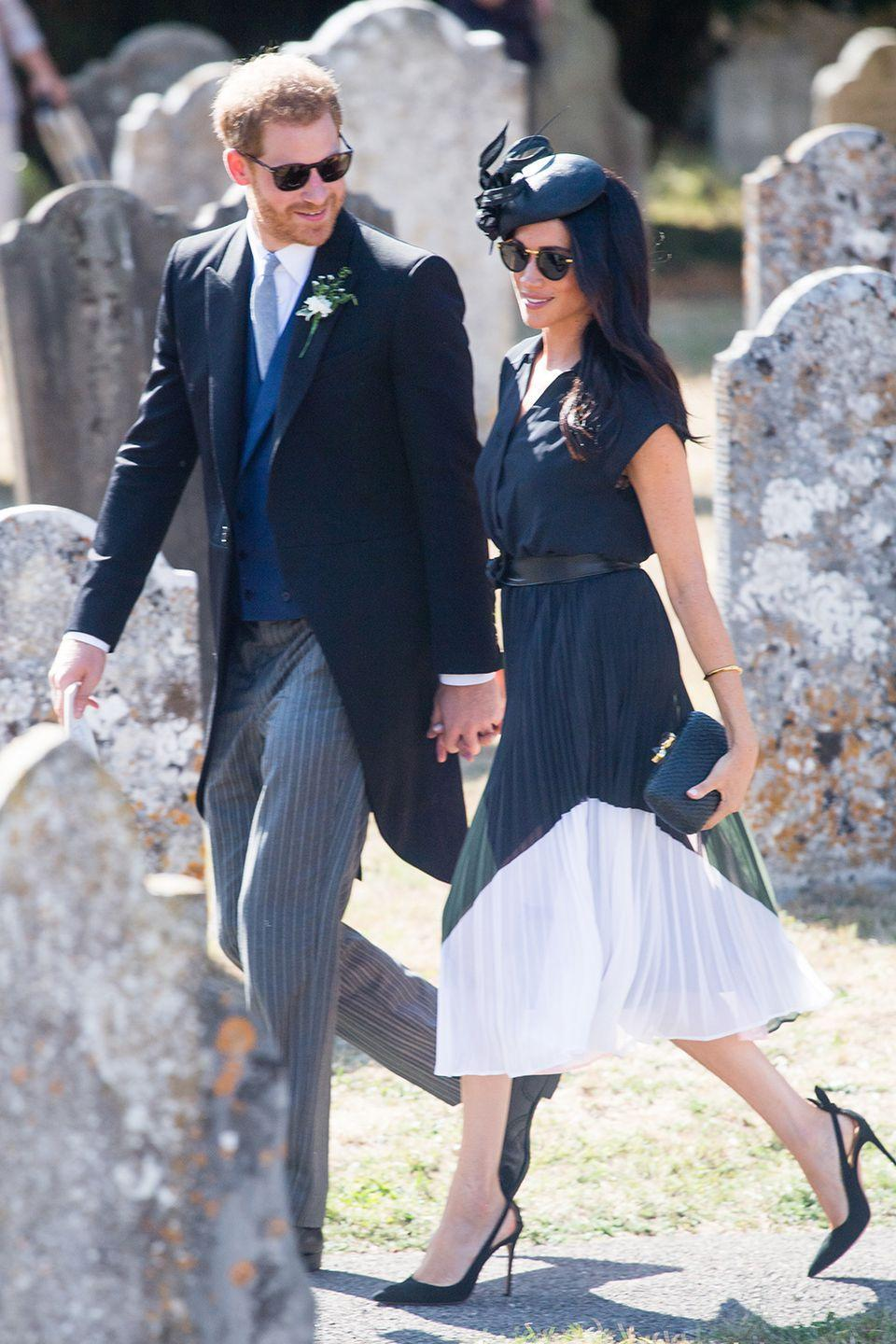 <p>Meghan celebrated her 37th birthday at the wedding of Charlie Van Straubenzee and Daisy Jenks, but Prince Harry made sure she was still the centre of his attention with this loving gaze. </p>