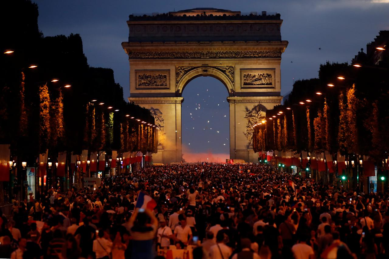 <p>France fans react on the Champs-Elysees after defeating Belgium in their World Cup semi-final match. REUTERS/Charles Platiau </p>