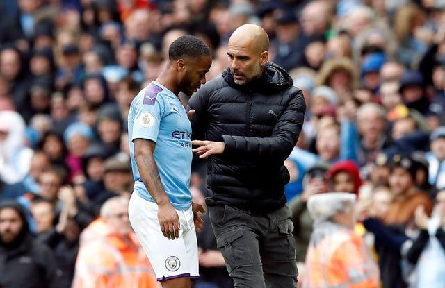 Manchester City manager Pep Guardiola and Raheem Sterling